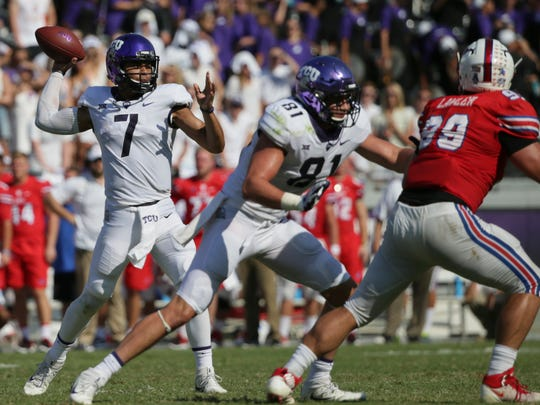 TCU quarterback Kenny Hill (7) pass as teammate tackle L.J. Collier (91) blocks SMU defensive end Justin Lawler (99) during the second half an NCAA college football game in Fort Worth, Texas, Saturday, Sept. 16, 2017. TCU won 56-36.