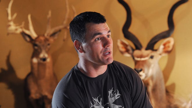 Indianapolis Colts kicker Adam Vinatieri has a love for hunting, big game hunting. His office in his Carmel home is decorated wall to wall with his hunting trophies.