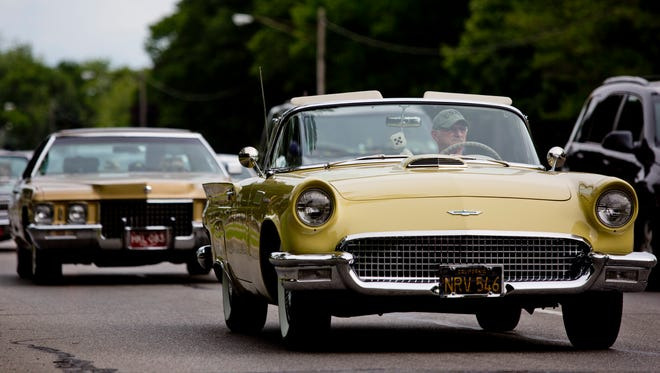 Classic cars cruise during Cruise Night Friday, June 26, 2015 along Pine Grove Avenue in Port Huron and Fort Gratiot.