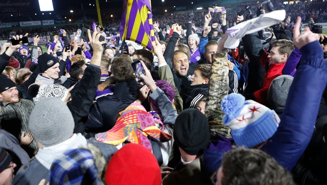 Louisville City FC fans storm the field.