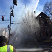 Emergency officials in Covington, Kentucky are responding to a two-alarm fire Wednesday morning, according to emergency communications.