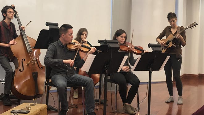 Akron-based singer-songwriter-musician Angie Haze (right) rehearses with Canton Symphony musicians (left to right) Jacob McAleavey, Alexander Lee, Zoë Moskalew and Maia Hoffman, prior to October's Divergent Sounds concert.