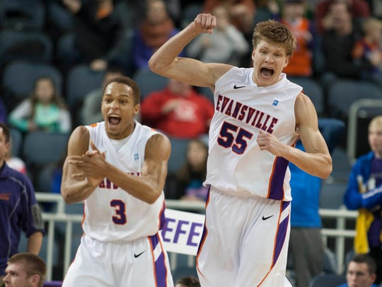 Evansville Aces center Egidijus Mockevicius (55) and guard Jaylon Brown (3) celebrate their victory over Northern Iowa Panthers in the second half of the game at Ford Center. The Evansville Aces beat the Northern Iowa Panthers by the score of 52-49.