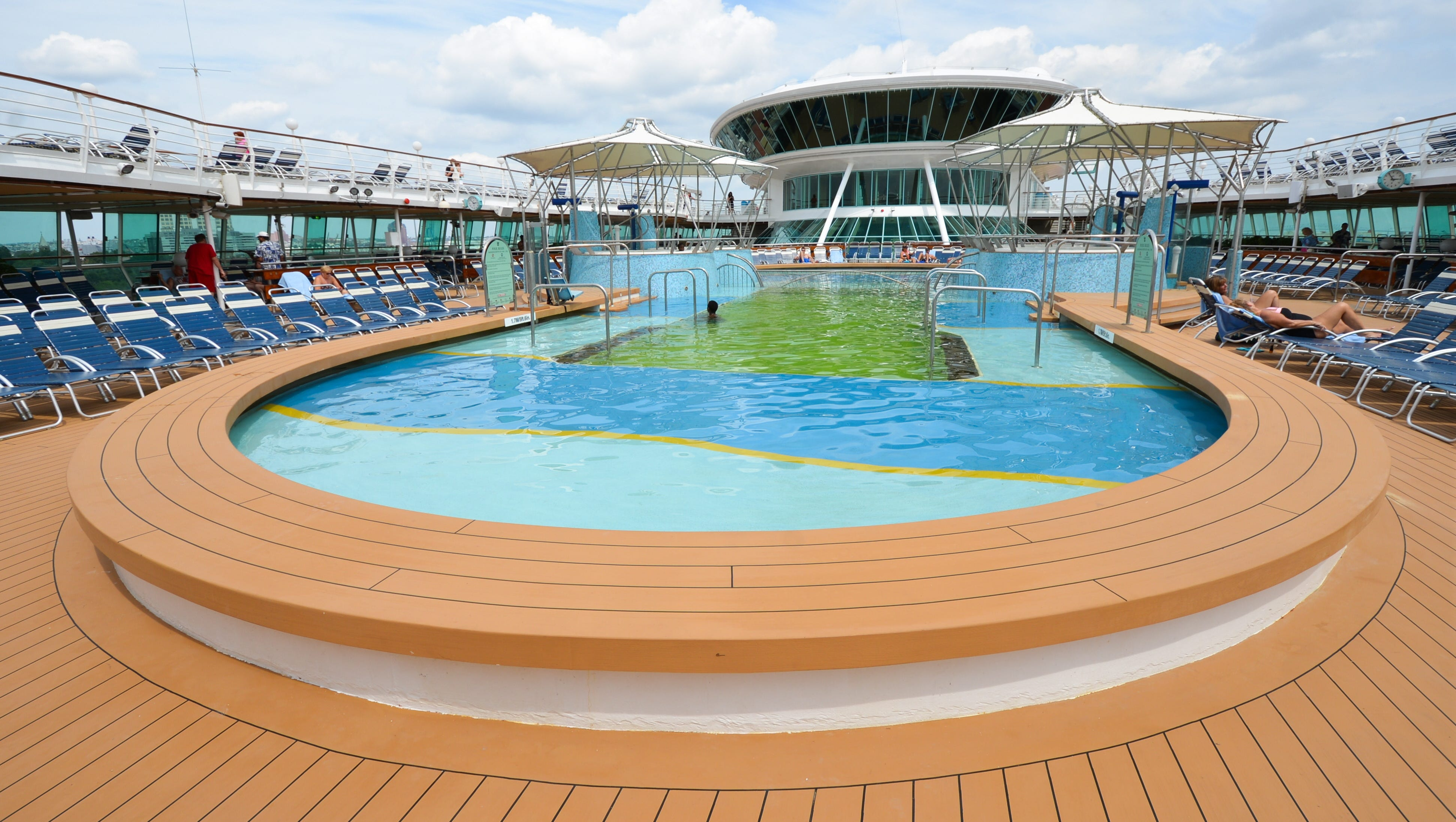 In addition to hot tubs, Grandeur of the Seas' main pool is surrounded by a shallow wading area.