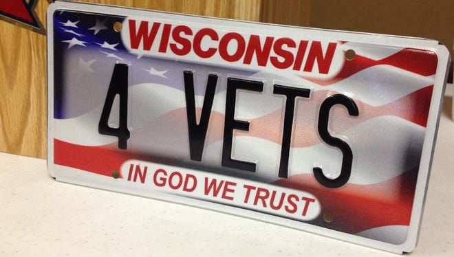 The Wisconsin Department of Transportation says the plates featuring an American flag in the background will be available for purchase after Jan. 1, 2015.
