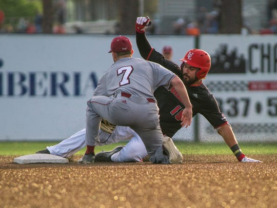 UL first baseman Tyler Stover slides to second during the Ragin' Cajuns' 6-2 loss to Troy on Friday night. Stover went 2-for-3 with one RBI.