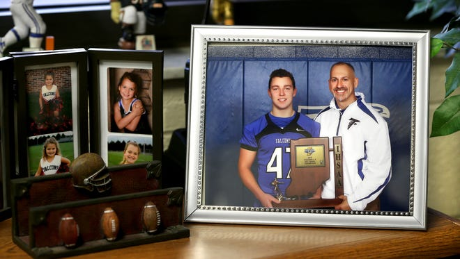 A copied photograph of North Vermillion High School football player Braeden Hollowell and his dad and athletic director Marty Brown. Hollowell and two other girls died in an accident where driver and best friend Ethan Lee survived on Jan. 2, 2015. On Saturday, Feb. 7, 2015, the school retired the jersey of Hollowell between the third and fourth periods of the basketball game against North Central High School.