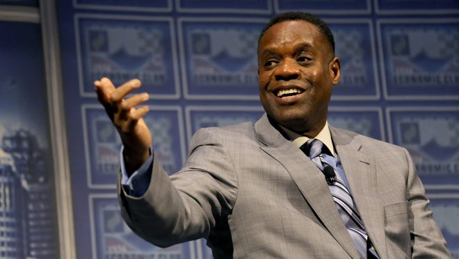 Kevyn Orr acknowledges members of his Emergency Management tean during a Detroit Economic Club Luncheon at Cobo Center in Detroit on Tuesday, Jan. 27, 2015.
