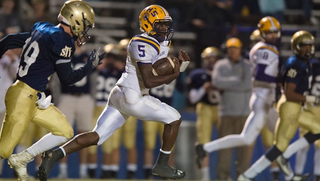 Tallassee's Markevious Mathews (5) runs for a 90-yard touchdown during the AHSAA playoff football game on Friday, Nov. 11, 2016, in Montgomery, Ala.