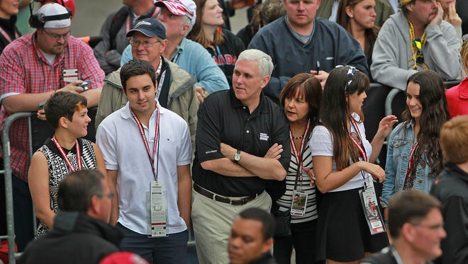 Indiana Governor Mike Pence, center, and his family watched as the drivers were introduced before the 97th running of the Indianapolis 500 on May 26, 2013.  Kelly Wilkinson / The Star