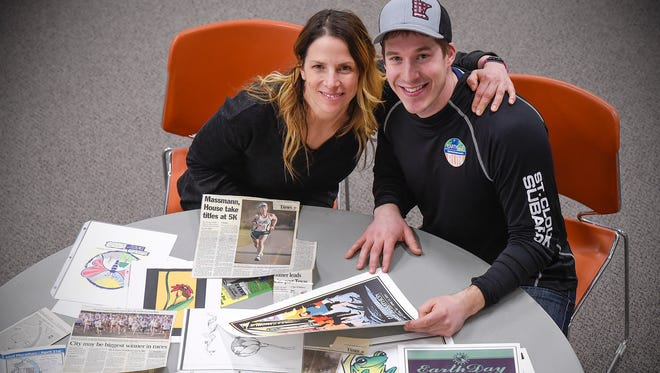 Christina Haukos organized the first Earth Day run in 2000 and now her son Evin organizes it shown Friday, April 13, with some photos and posters from past races.