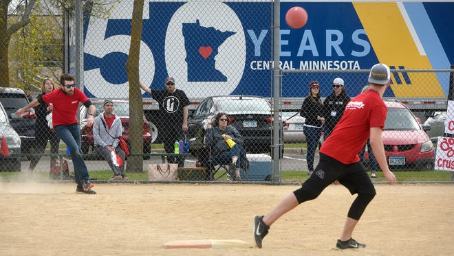Teams compete during the United Way of Central Minnesota's Kick Summer Hunger Kickball Tournament Friday, May 11, at Whitney Regional Park in St. Cloud.
