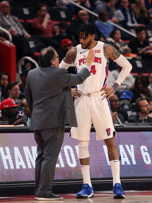 Detroit Pistons head coach Stan Van Gundy, left, talks with forward Eric Moreland during the first half of an NBA basketball game against the Dallas Mavericks, Friday, April 6, 2018, in Detroit. (AP Photo/Carlos Osorio)