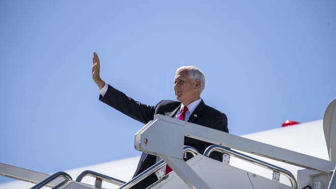 Vice President Mike Pence arrives Wednesday at Dobbins Air Reserve Base in Marietta, Ga.