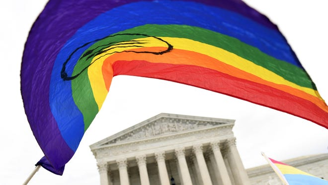 In this Oct. 8, 2019, file photo, protesters gather outside the Supreme Court in Washington, where the Supreme Court was hearing arguments in the first case of LGBT rights since the retirement of Supreme Court Justice Anthony Kennedy. LGBT-rights activists are looking ahead as they celebrate a major victory in the Supreme Court regarding job discrimination, They hope the June 15, 2020, decision spurs action against other forms of bias against their community and undermines the Trump administration's near-total ban on military service by transgender people.