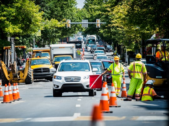 Cars navigate construction on Cumberland Street on Wednesday, August 9, 2017.