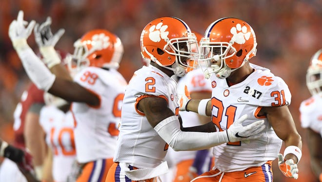 Clemson defensive back Ryan Carter (31) celebrates with cornerback Mark Fields (2) after a defensive stop against Alabama during the 1st quarter of the National Championship at Raymond James Stadium in Tampa on Monday, January 9, 2017.