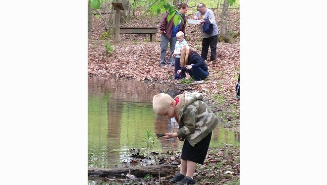 All ages are invited to spend Spring Break 2017 in Bowie Nature Park.  Pictured - Fairview youth get closer to nature on spring hike.