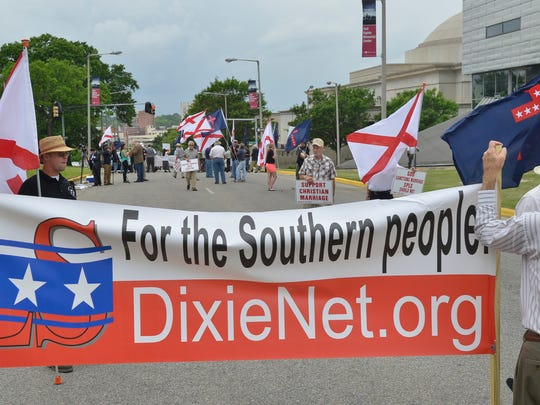 The Council of Conservative Citizens and the League of the South protest outside Southern Poverty Law Center due to the SPLC challenging the state's Sanctity of marriage laws on Friday, May 9, 2014.