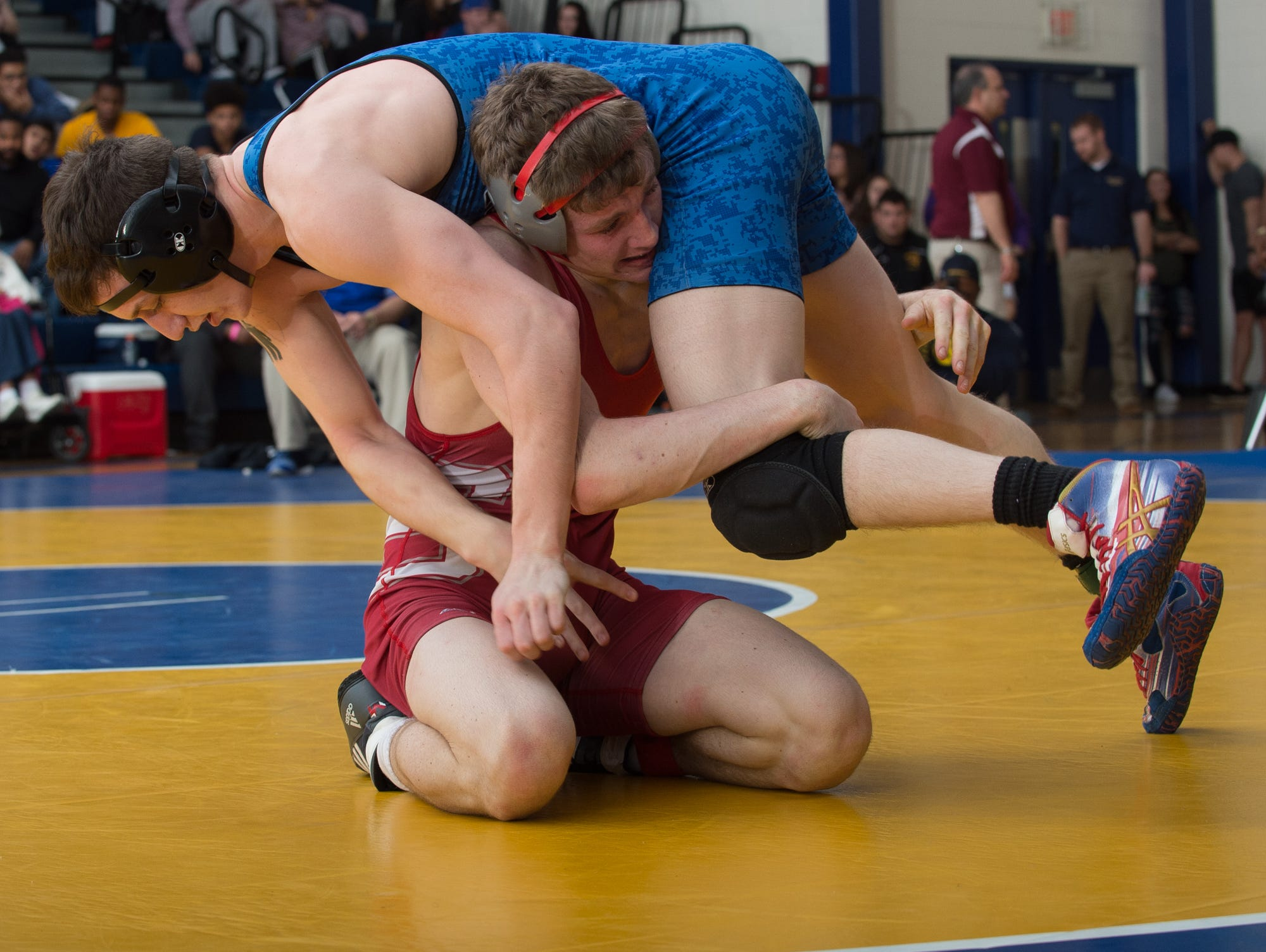 Smyrna's Chase Archangelo lifts Dover's Nicholas Lee on to his shoulder in the 145 pound championship match at the Henlopen Conference wrestling tournament at Sussex Central High School.