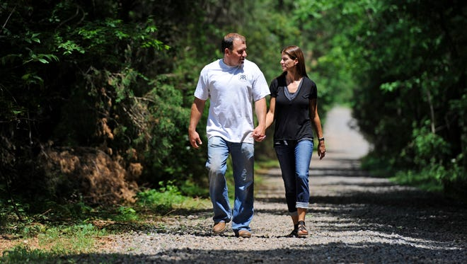 Ryan Newman and his wife, Krissie, walk the grounds at their Rescue Ranch for animals.