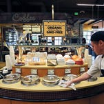 In this Oct. 23 file photo, a grocery store employee wipes down a soup bar with a display informing customers of organic, GMO-free oils, in Boulder, Colo. A large majority of Americans support labeling of genetically modified foods, whether they care about eating them or not.