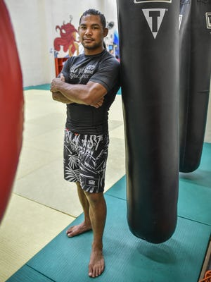 "In this file photo, ""Baby"" Joe Tamianglo gets ready to train at the iFit gym in Tamuning. Taimanglo beat Darrion Caldwell in Bellator 159, making him the No. 1 contender in the bantamweight division and setting up a match with champion Eduardo Dantas."