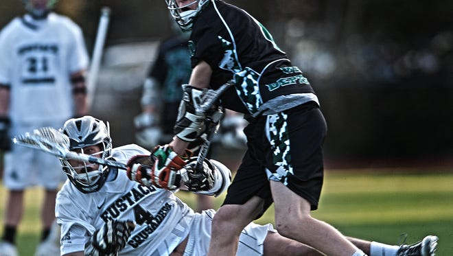 Is repeated cross-checking slows the game in Boys Lacrosse ? Jose F. Moreno/Courier-Post