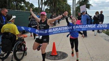 Former Mars Hill University runner Becca Pizzi, seen here winning the Miami marathon, is running seven marathons on seven continents in seven days.