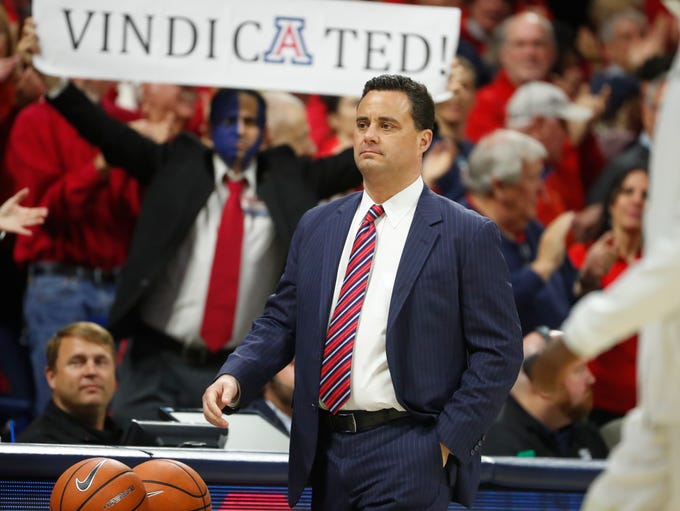 Arizona's head coach Sean Miller walks onto the court