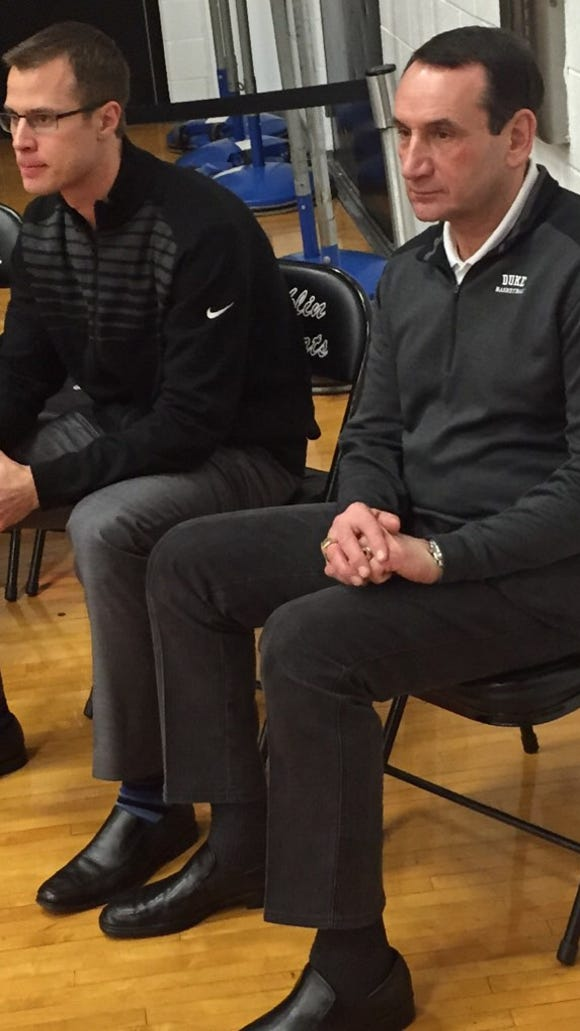 Duke coach Mike Krzyzewski (right) watched the Valley View at Franklin game tonight.