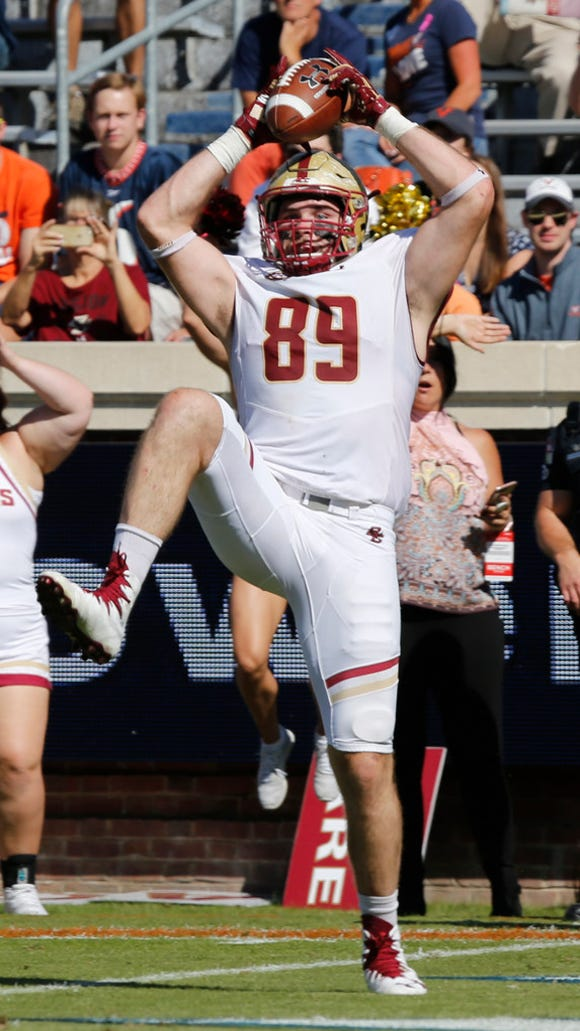 Boston College tight end Tommy Sweeney (89) hauls in a touchdown pass during the first half of an NCAA college football game against Virginia in Charlottesville, Va., Saturday, Oct. 21, 2017