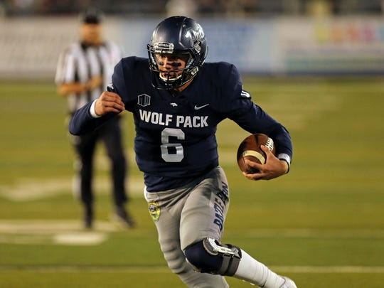 Wolf Pack quarterback Ty Gangi scores on a 17-yard