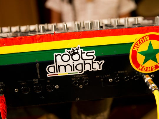 Roots Almighty keyboardist Ras Chul, from left, singer