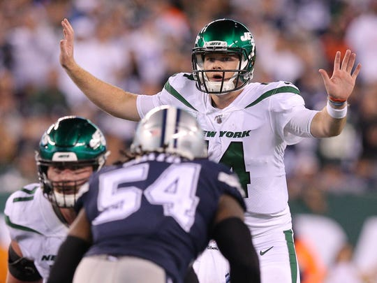 Oct 13, 2019; East Rutherford, NJ, USA; New York Jets quarterback Sam Darnold (14) calls a play against the Dallas Cowboys during the fourth quarter at MetLife Stadium. Mandatory Credit: Brad Penner-USA TODAY Sports