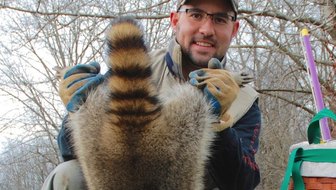 The author made the most of his holiday vacation by spending time with family and enjoying the outdoors, including trapping a 16-pound raccoon on his property.