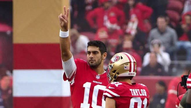 San Francisco 49ers quarterback Jimmy Garoppolo (10) gestures to the fans before the game against the Jacksonville Jaguars during the first quarter at Levi's Stadium.