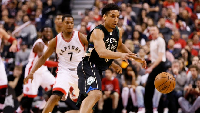 Bucks guard Malcolm Brogdon gets control of the ball against the Toronto Raptors in their opening playoff game Saturday.