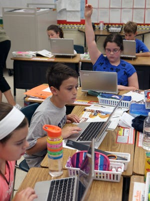 Third grade students in Mike Gray's class at the Cottle School in Tuckahoe, do their work on Chromebook's, June 4, 2014.