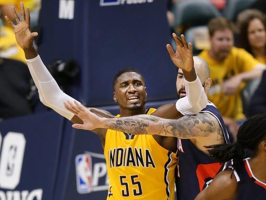 Pacers center Roy Hibbert is pressured by Atlanta Hawks