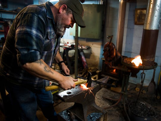 Bruce Cluck, of Hanover, works inside his blacksmith shop at his Carlisle Pike home Wednesday Jan. 20, 2016. Cluck has been practicing the hobby of historical blacksmithing for eight years and works on historical reproductions, including kitchenware, tools, decorative objects and knives.