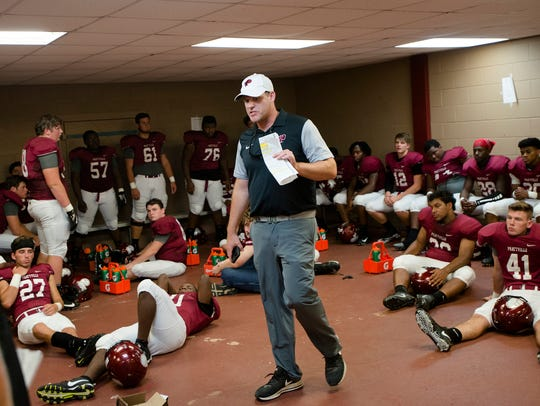 Prattville head coach Chad Anderson speaks to his players