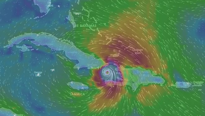 A Windy TV forecast model shows Hurricane Matthew spinning in the Caribbean Sea.