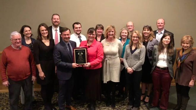 Intercity State Bank directors, officers and staff members accept a Business of the Year Award from the South Area Business Association at SABA's annual dinner in January.