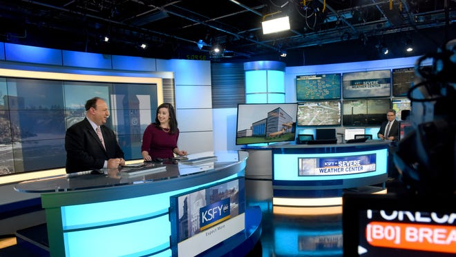 KSFY anchors Brian Allen, Courtney Collen and meteorologist Phil Schreck talk in-between commercials during the 5 o'clock news last week.