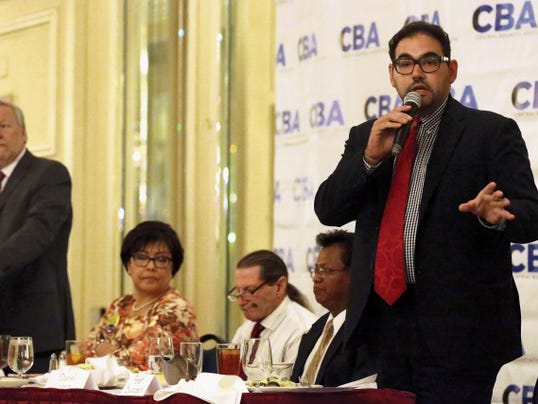 District 1 candidate Peter Svarbein, one of six candidates vying for the seat being vacated by present District 1 Rep. Ann Morgan Lilly, addresses audience members at the CBA monthly luncheon held Wednesday at the Camino Real Hotel in Downtown.