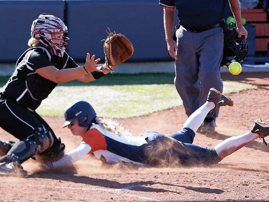 Rudy Gutierrez—El Paso Times UTEP's Courtney Clayton, 21, slides into home plate for a score while NMSU catcher T. Reedy waits for the throw Tuesday at Helen Of Troy Field on the UTEP campus.