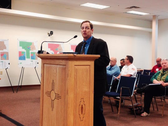 Michael Sharp, vice president and director of Redistricting Services for Research & Polling Inc., discusses redistricting Grant County from three to five districts during Thursday's County Commission meeting in Silver City. Randal Seyler - Sun-News