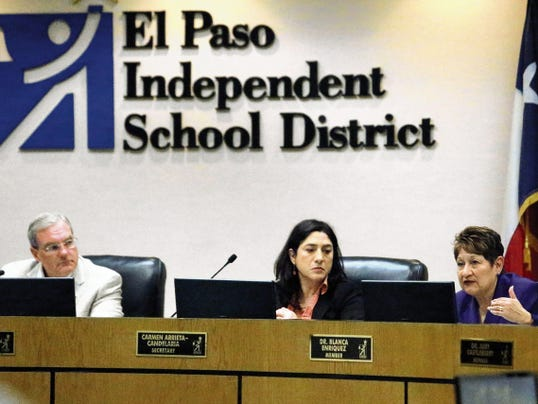 Rudy Gutierrez—El Paso Times Blanca Enriquez, right, speaks during Thursday's El Paso school district Board of Managers meeting on possible school consolidation. Other board members include secretary Carmen Arrieta-Candelaria, center and president Dee Margo, left.