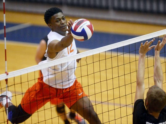 Northeastern's Jeff Reynolds hits the ball over the net during Friday's District 3 Class AA boys' volleyball championship game at Dallastown Area High School. Northeastern won its sixth district title in seven years with a 3-0 sweep of Lancaster Mennonite.